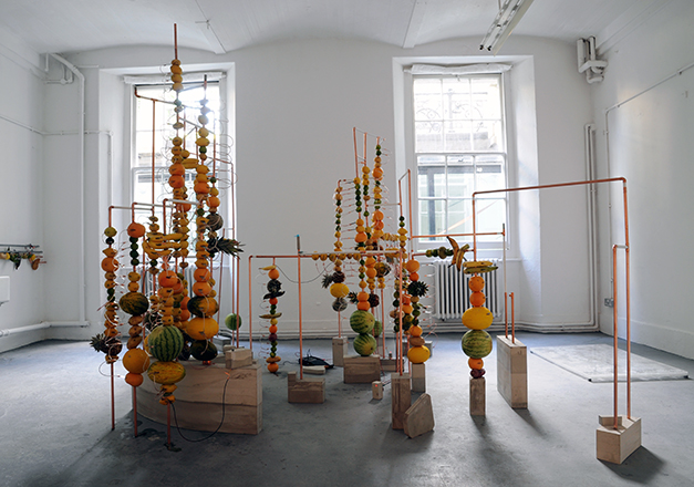 _Jeehee Park, fruit battery, 2014. Copper pipes, concrete, fruits, copper clips, zinc plate, variable dimension