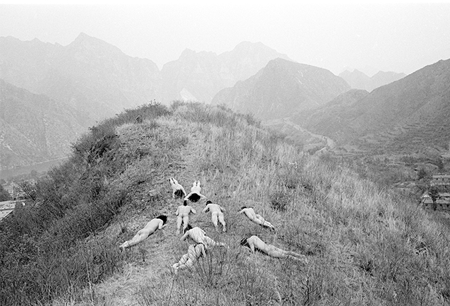 "Yingmei Duan, ""Nine Holes"", 1995. Pigment on archival paper, Photograph of live performance with East Village artists, Beijing, China, 100 x 148 cm."
