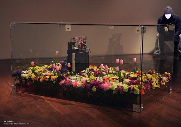 """Sang Jin Kim, """"Air Purifier"""", 2011, Air Purifier, Live Flowers, Water, Glass Frame, 160 x 100 x 80 cm."""