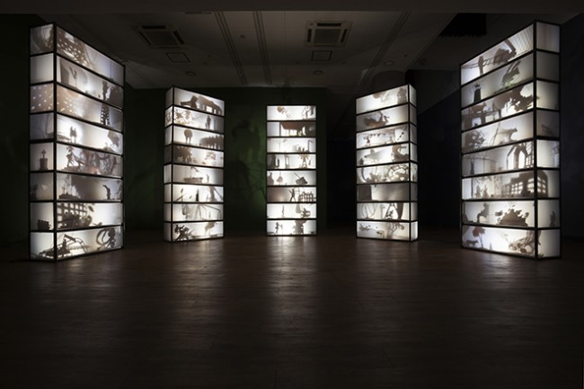 "Mioon, ""Auditorium"", 2014, Cabinet, object, Lights and Motor, 700 x 500 x 300 cm."