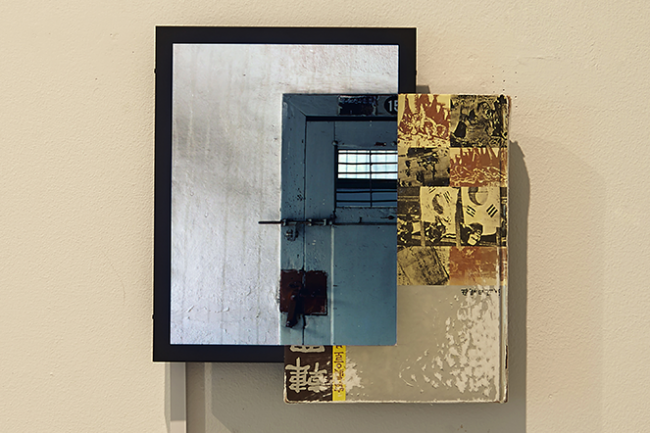 """Geum MinJeong, """"sites_imprisoned"""", 2014. text book, LED monitor, mixed media, 40 x 40 x 20 cm."""